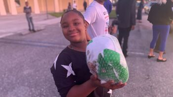 Girl holding a turkey